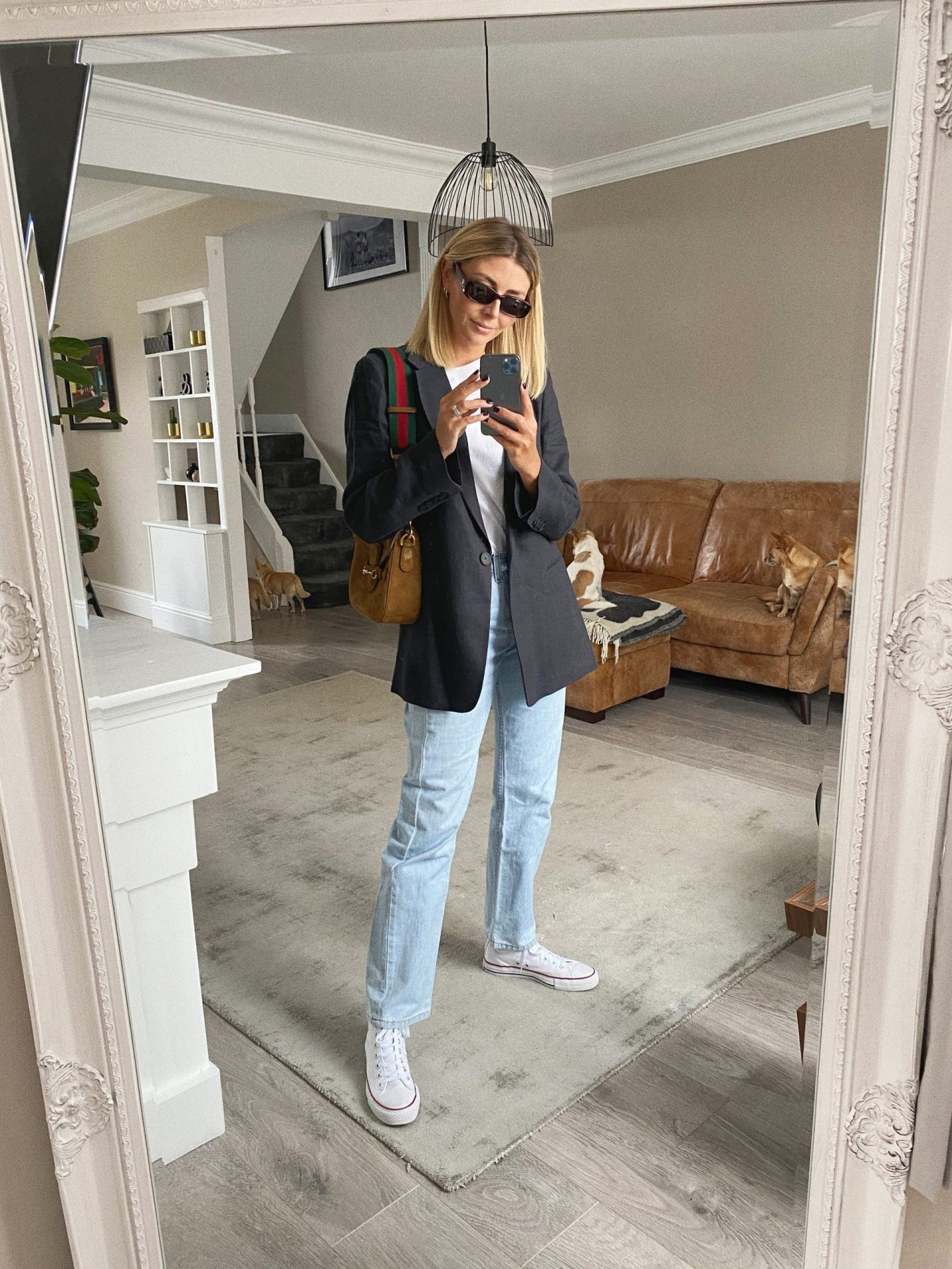 Emma Hill wears navy blazer, bleached 501 jeans, white t-shirt, white converse hi tops, Gucci Ladyweb bag in tan suede