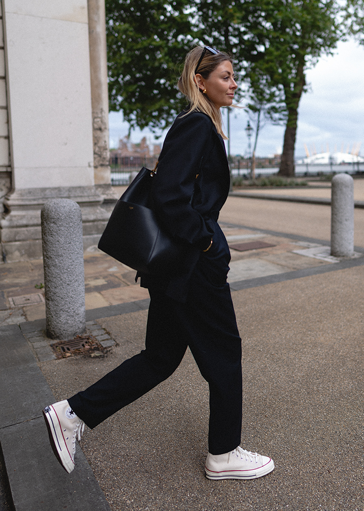 Emma Hill style, black blazer, black tailored trousers, Celine Seau Sangle bucket bag, parchment converse hi tops, chic casual outfit_