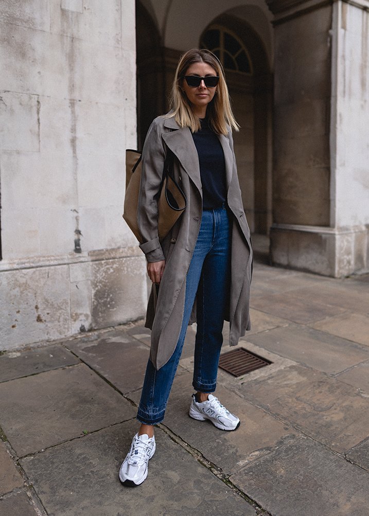 Emma Hill style, khaki green trench coat, navy blue t-shirt, raw hem straight leg jeans, New Balance 530 trainers, Canvas tote bag, transitional casual outfit 2020