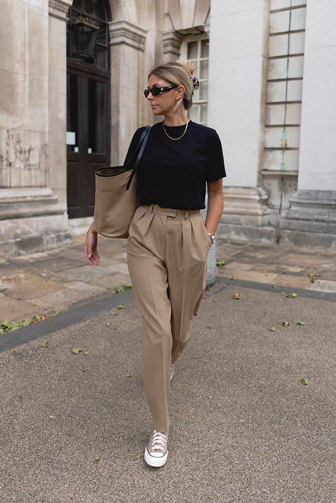 Emma Hill style. Black t-shirt, camel tailored trousers, neutral canvas bag, gold jewellery, camel converse hi tops. Chic casual Summer outfit blog