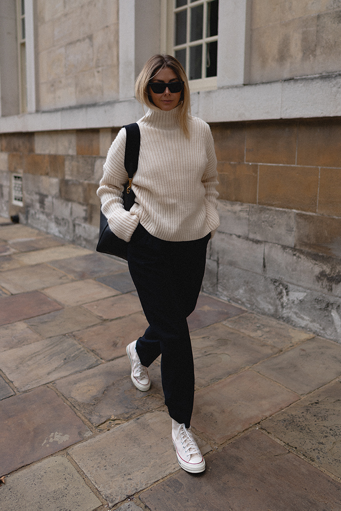 Emma Hill style. Cream ribbed chunky knit jumper sweatrer black trousers, Celine Seau Sangle leather bag, cream parchment converse chuck 70, autumn style outfit