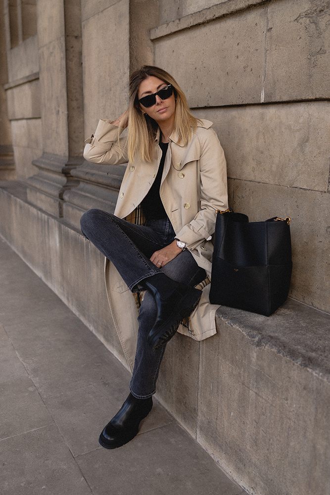 Emma Hill style. Vintage Burberry classic trench coat, washed black straight leg jeans, black chunky leather boots, Celine Seau Sangle bag. Casual chic Autumn Fall outfit