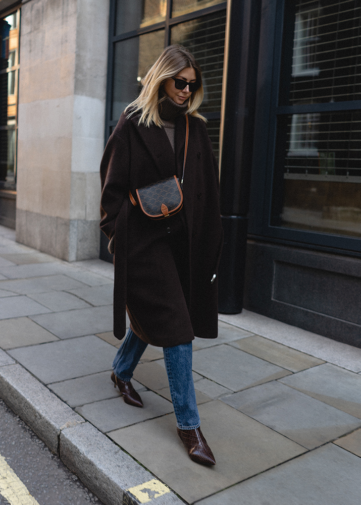 Emma Hill Autumn Winter style. Brown wool belted oversized coat, straight leg jeans, brown mock croc pointed toe ankle boots, Celine Folco cross body bag. Autumn Winter outfit