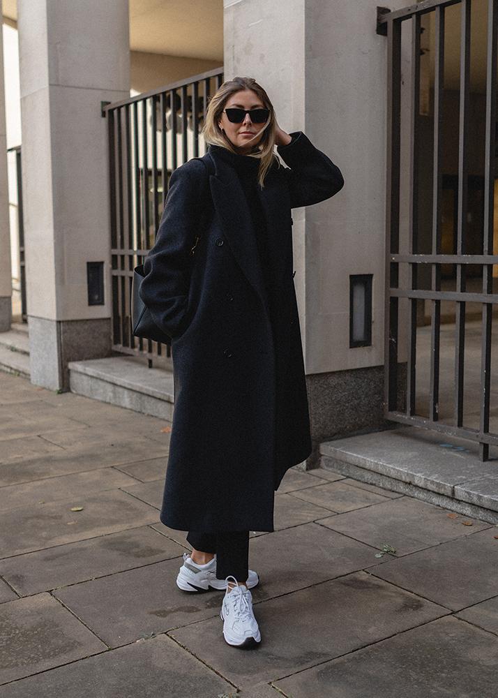Emma Hill Autumn Winter style. Grey oversized masculine wool coat, Celine Seau Sangle, Nike M2K tekno trainers, tailored trousers. Autumn Winter outfit ideas