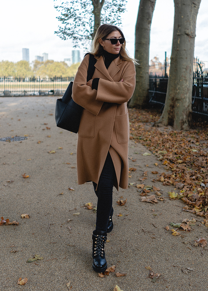 Emma Hill Autumn style. Camel wool cashmere blend coat, black lace up hiker boots, casual autumn fall outfit