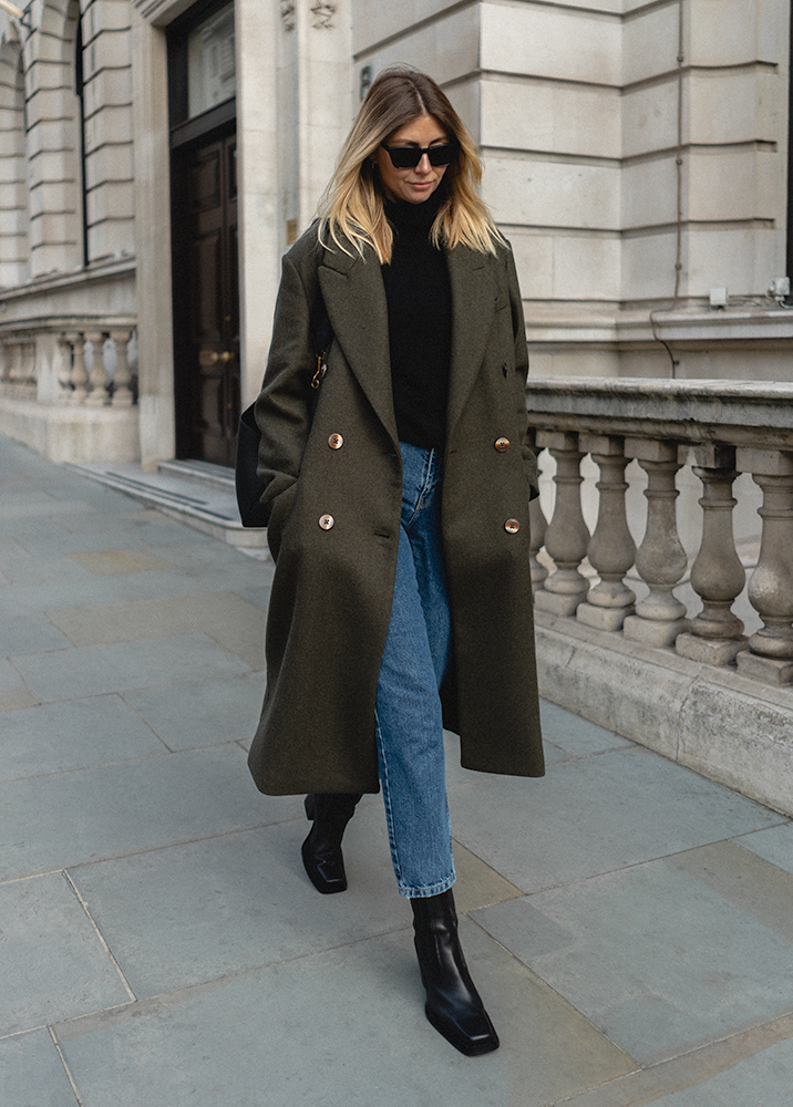 Emma Hill Autumn style. Green wool coat, cropped blue mom jeans, black leather square toe ankle boots, black cashmere roll neck jumper. Autumn Winter outfits