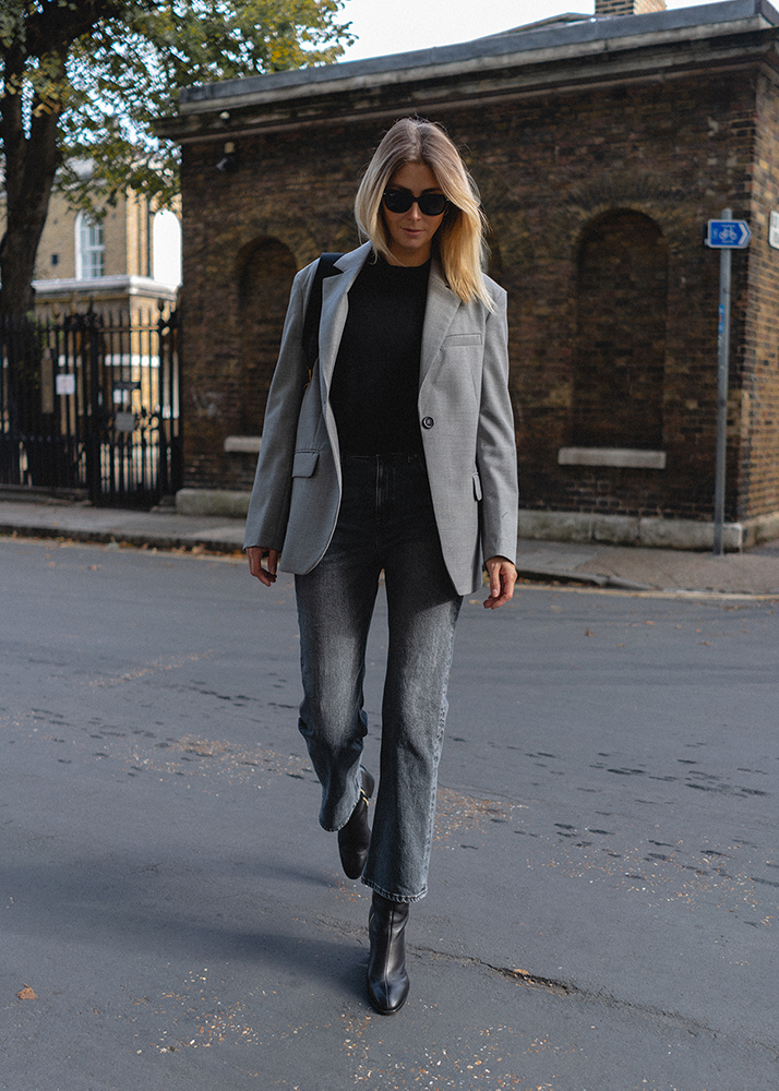 Emma Hill Autumn style. Grey blazer, black cashmere sweater, grey cropped kick flare jeans, black Celine Sea Sangle bag