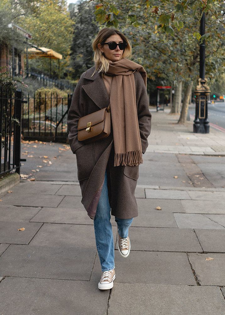 Emma Hill Autumn style. Taupe oversized wool coat, camel scarf, light wash straight leg jeans, Celine classic bag in camel leige leather, Converse Chuck 70 high tops. Casual Autumn Fall outfit