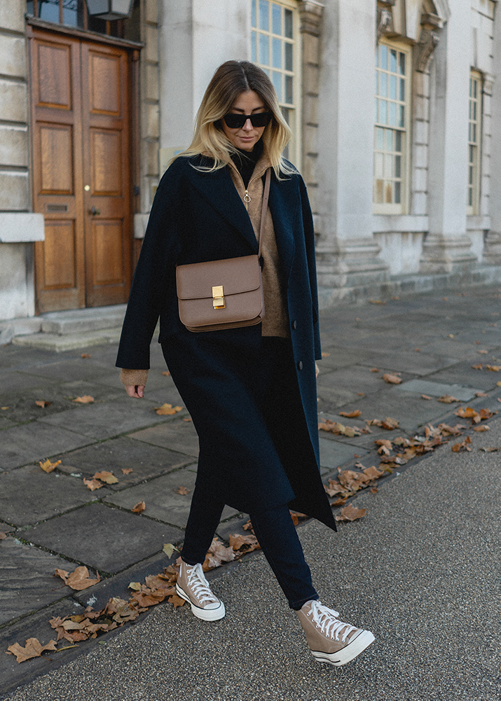 Emma Hill autumn style. Navy wool coat, camel zip neck jumper, dark blue skinny jeans, Camel leige leather Celine classic bag, camel Converse Chuck 70 trainers