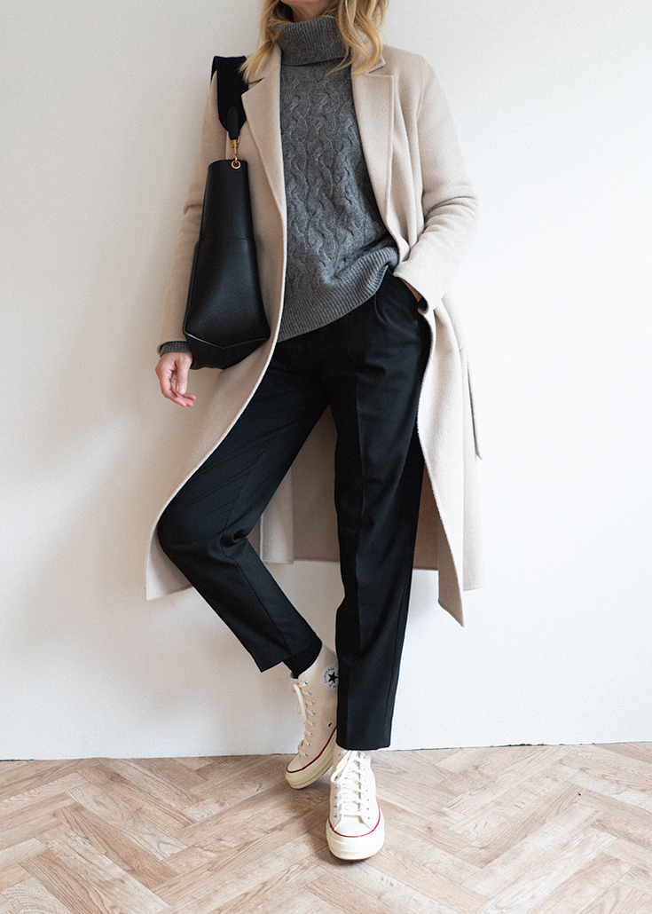 Cream coat, grey cable knit jumper, black tailored trousers, parchment converse chuck 70 high tops, black bucket bag