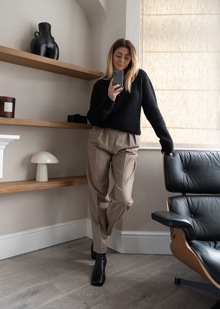 Emma Hill style. Black alpaca jumper, taupe tailored trousers, black square toe boots