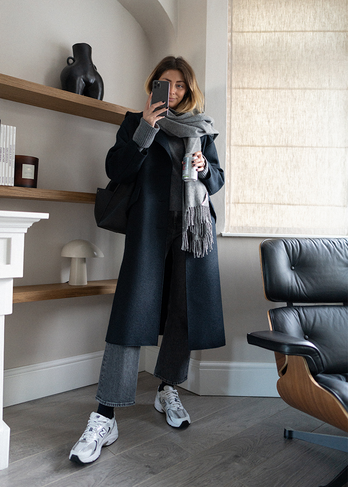 Emma Hill style. Navy coat, grey acne scarf, cropped kick flare grey jeans, New Balance 530 trainers