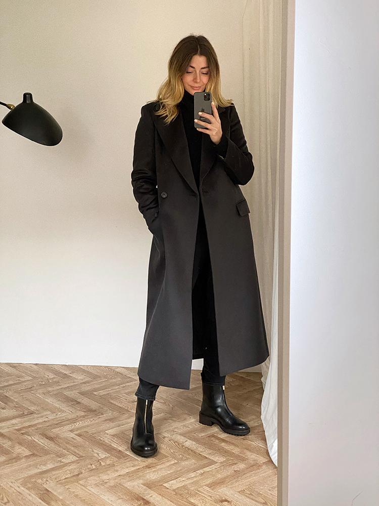 Grey long coat, black zip boots