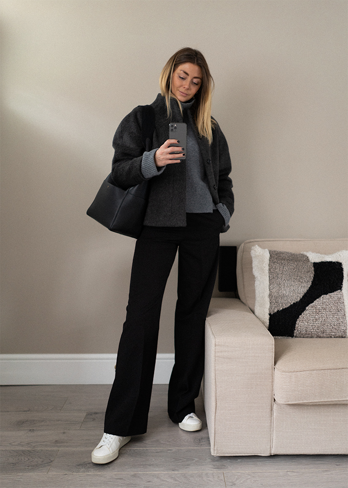 Grey wool jacket, grey roll neck jumper, black wide leg trousers, veja trainers, Celine Seau Sangle bag. Casual Winter outfit idea