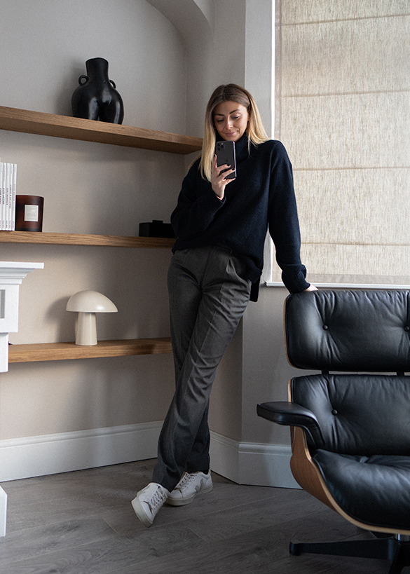 navy roll neck wool jumper, grey trousers, Veja campos