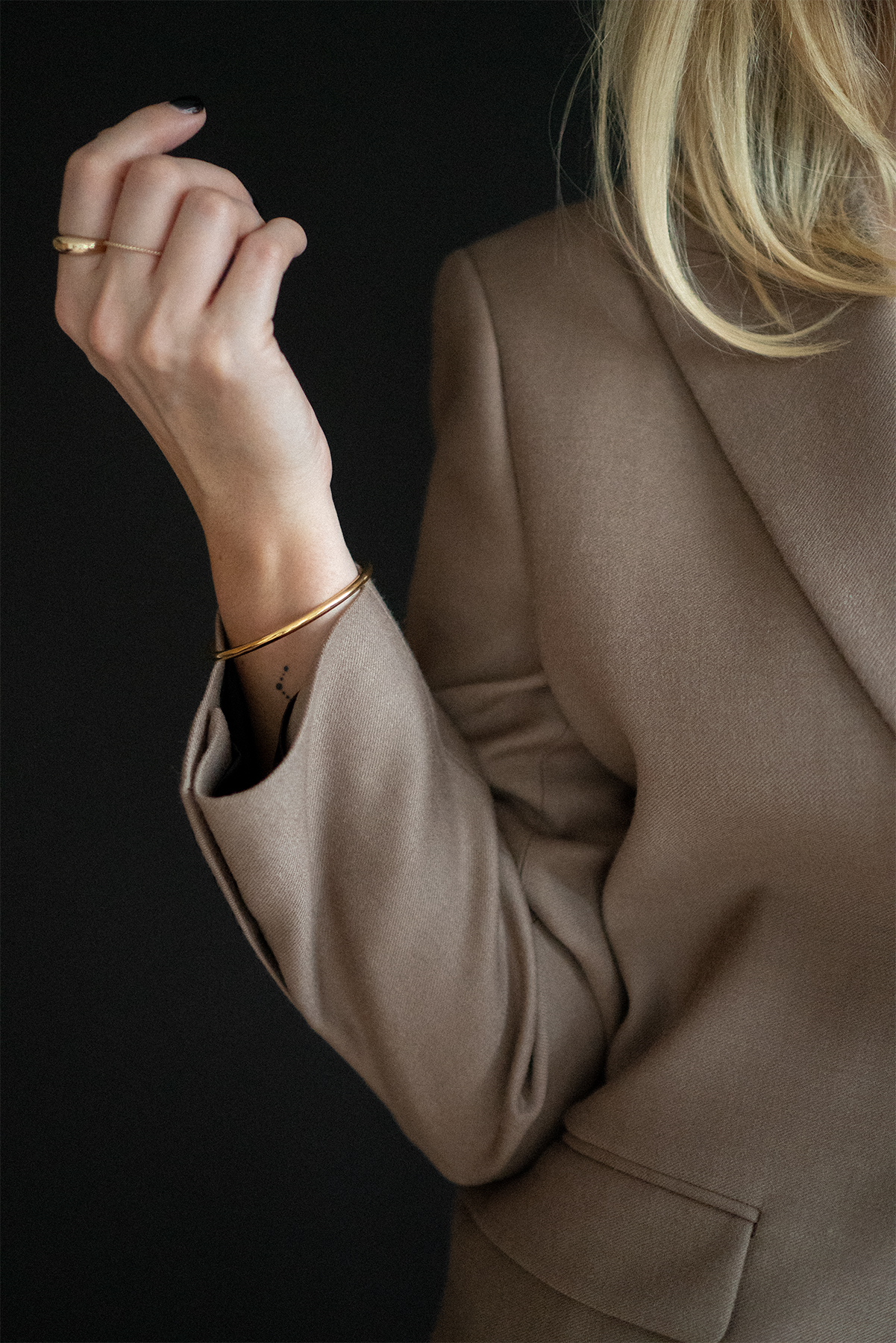 taupe blazer, gold bangle, gold rings