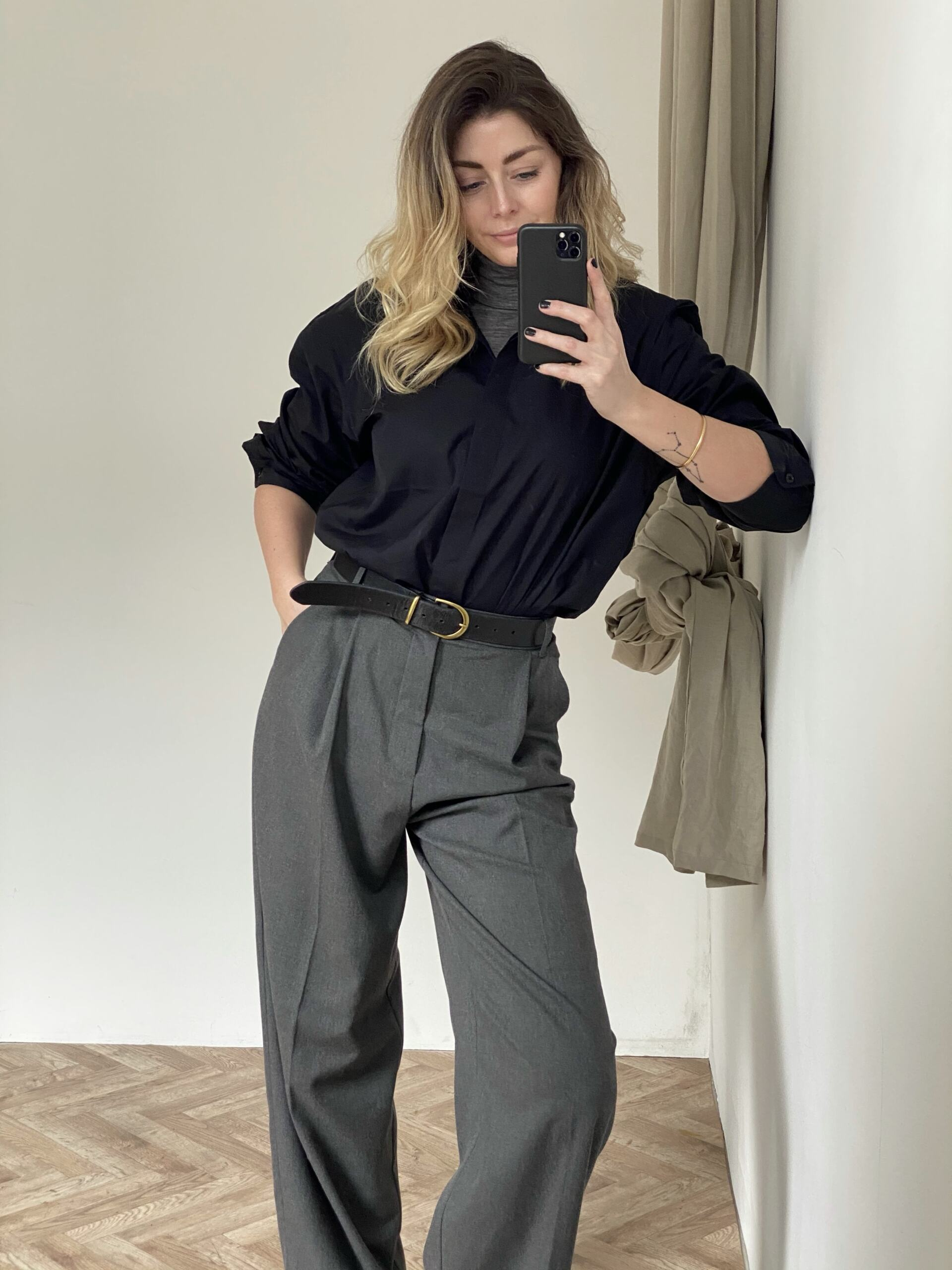 Emma Hill style. Black cotton shirt worn over grey polo neck, grey masculine trousers, black converse Chuck 70. Work inspired outfit