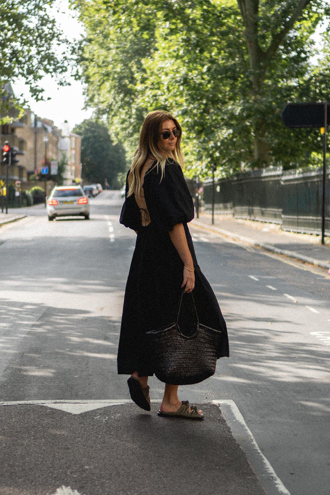 Emma Hill wears black puff sleeve KC The Brand lace up back Summer dress, Dear Frances Tye slides